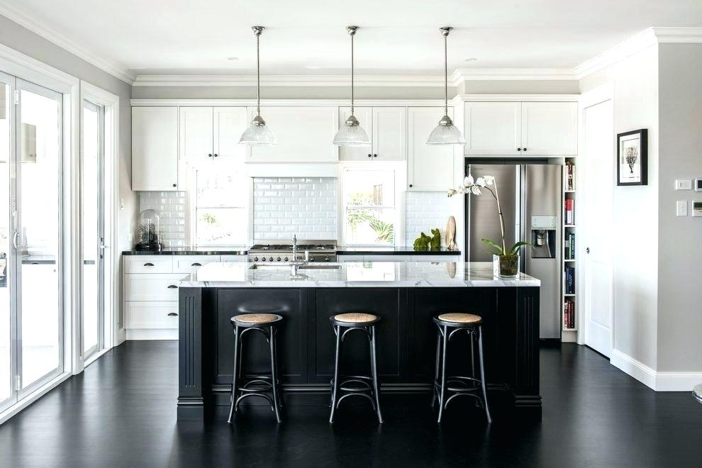 3. Black - Black accents are gaining popularity as one of the latest home design trends and we are loving it.Check out the sophistication and contrast it brings to this kitchen.