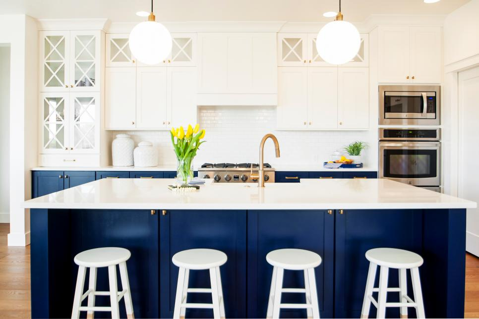 2. Navy - Navy is the perfect color to achieve that moody kitchen look. It's rich and will accent any modern kitchen that needs drama.A navy kitchen island can add definition and make your space feel larger.
