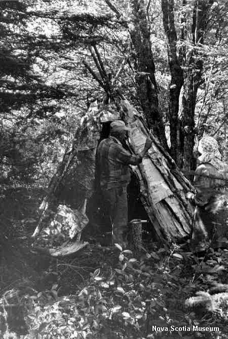Mi'kmaq trapper Mike Martin, July 1979, showing the construction of a small wigwam (used with permission)