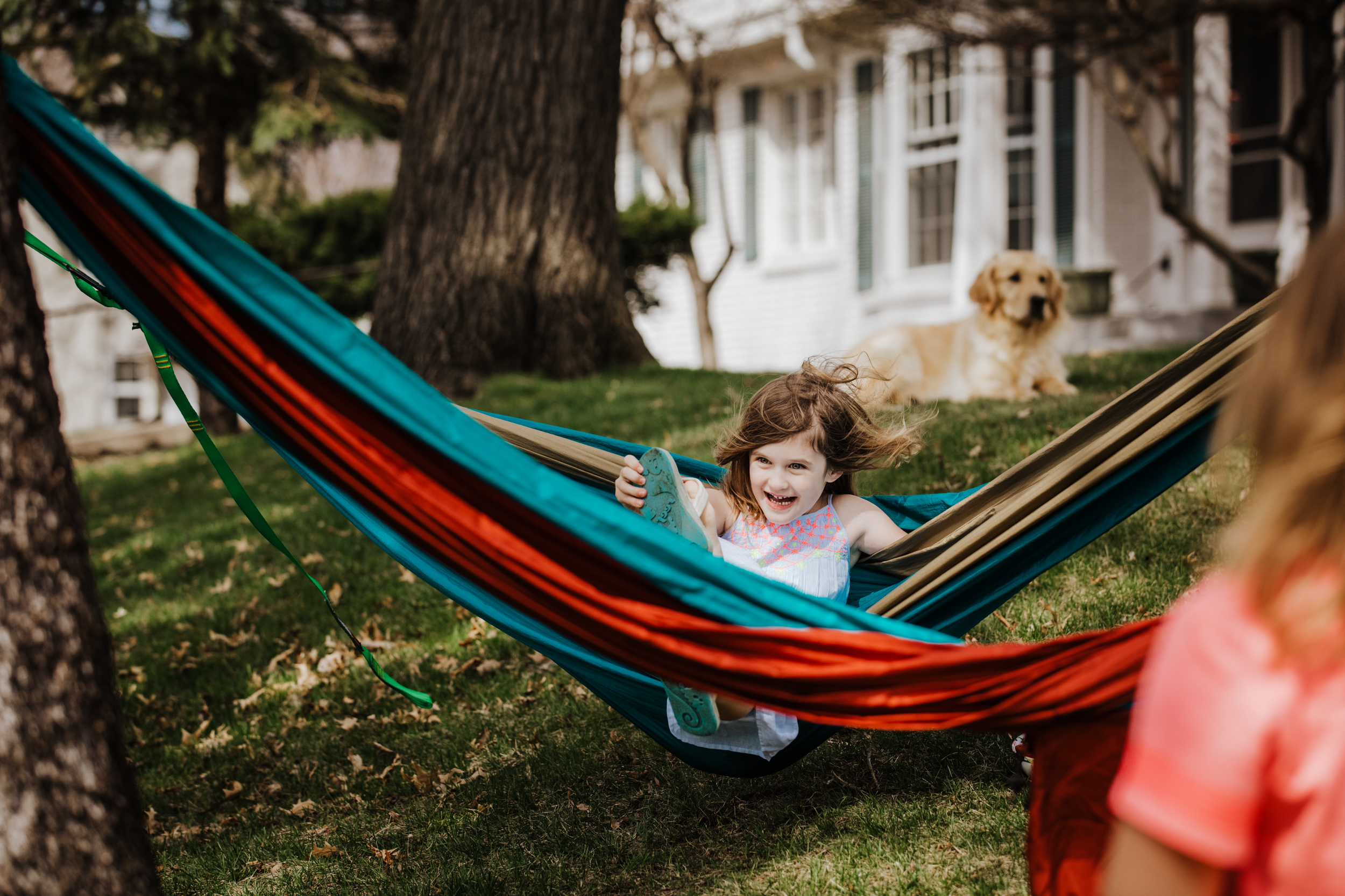 All she needs - sis, hammock and pup