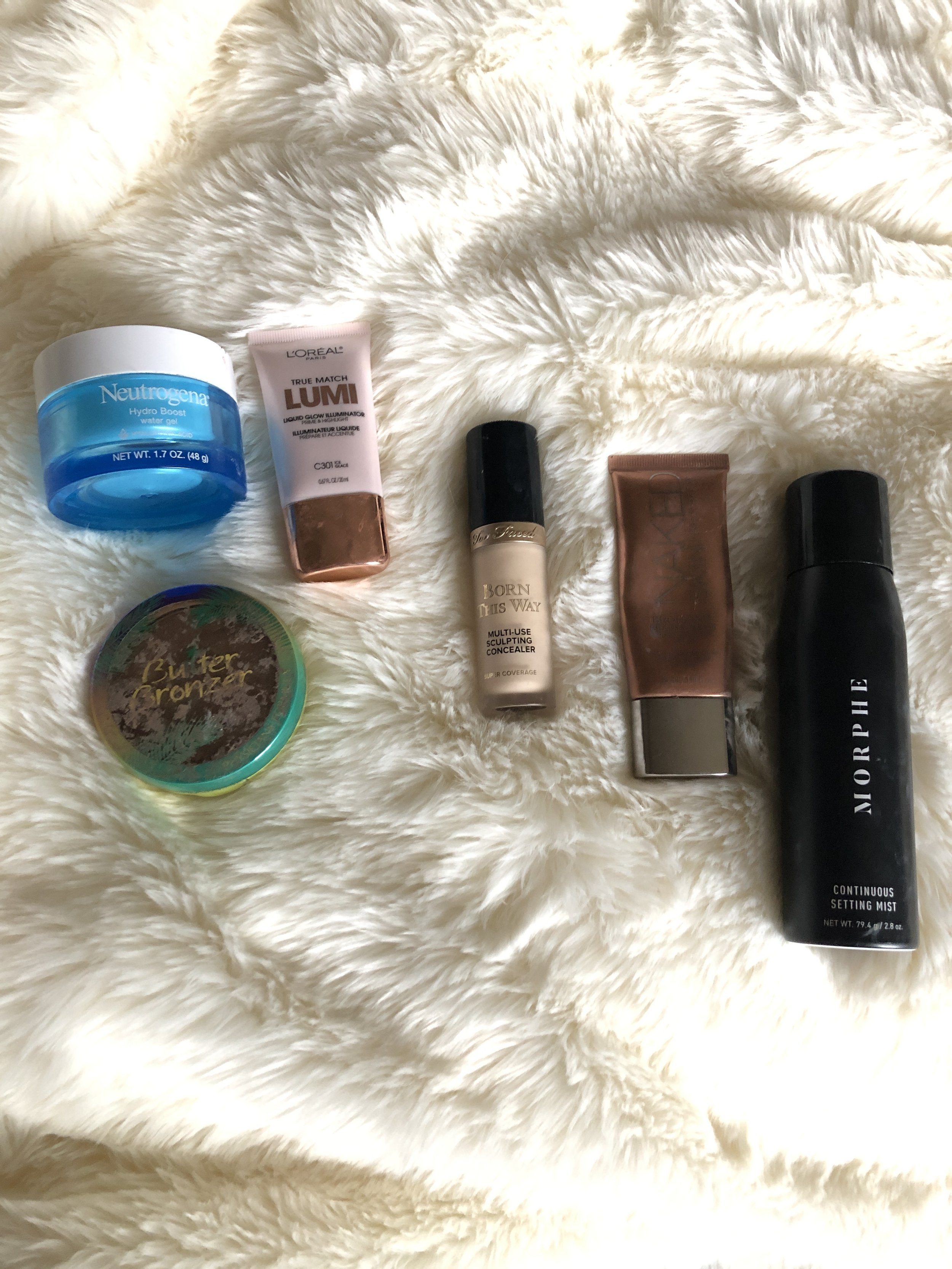 neutrogena hydro boost watergel, physican's formula butter bronzer, loreal lumi highlighter, born this way concealer, naked skin liquid bronzer, morphe setting spray,(not pictured- nars foundation)
