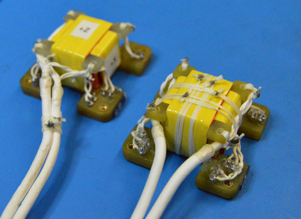 The two bare fluxgate sensors, which use coils of wire to precisely detect magnetic fields.