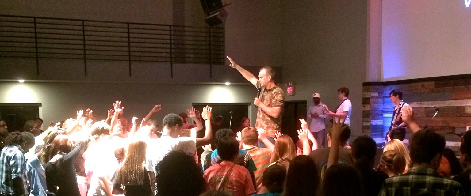 Cliff Graham on stage for a youth camp.