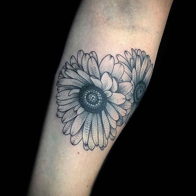 Daisies on the forearm @christambo #daisies #gerbera #blackandgrey #tattoo #dotwork #thesolidink #lovehatetattoos #miamiink #southbeach #miami