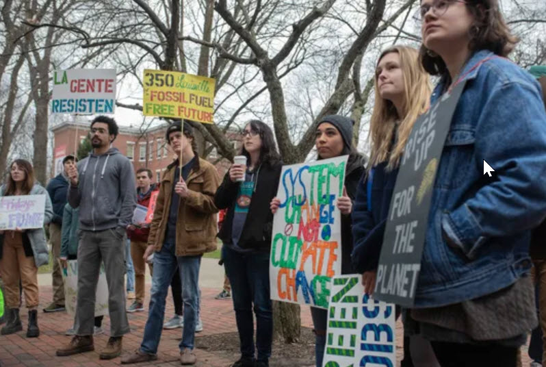 Attendees look on during a protest in support of the Green New Deal as  well as climate and social justice on the U of L campus Friday. Feb. 22,  2019 (Photo11: Alton Strupp/Courier Journal)