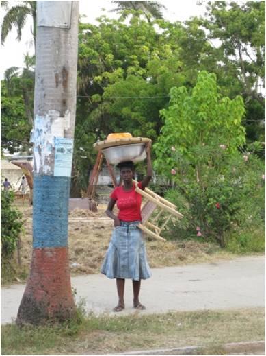 Women carrying a basket of wares in Cap Haitien, Haiti.
