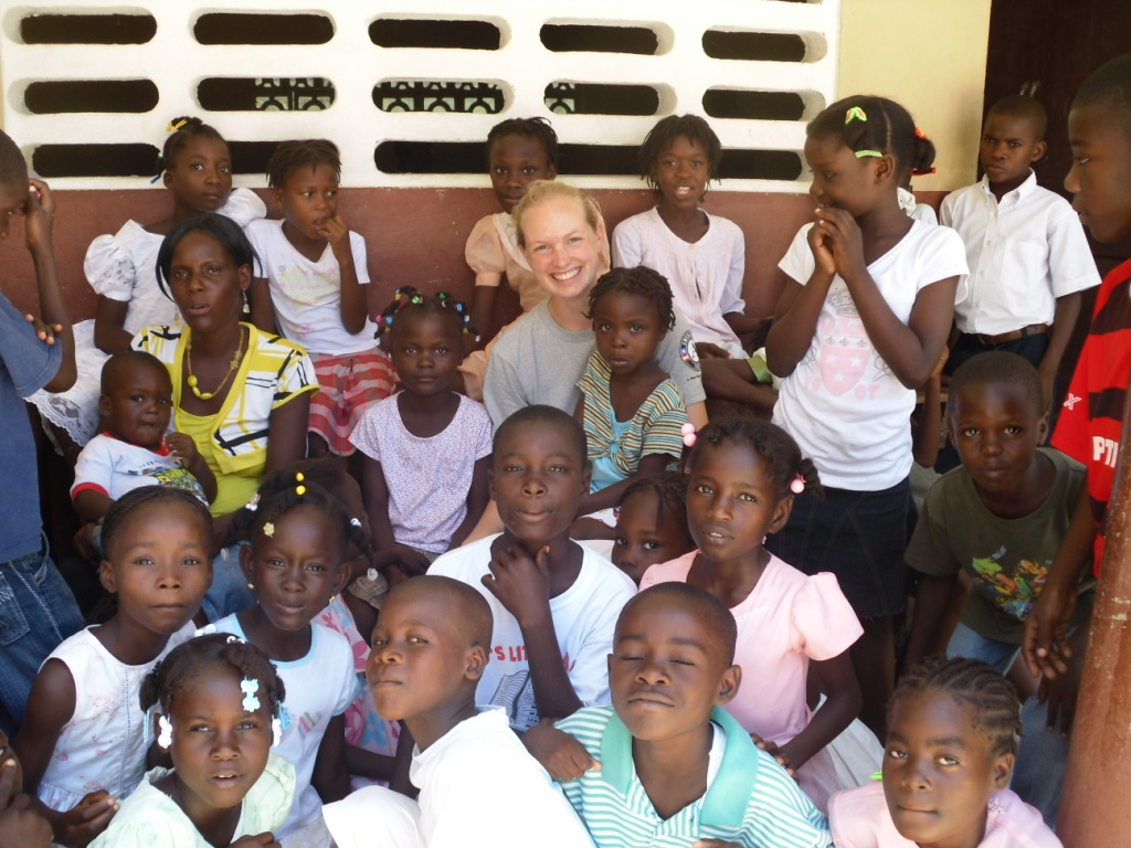 Children at a school outside of Cap Haitien pose with Meike during a GROW activity.