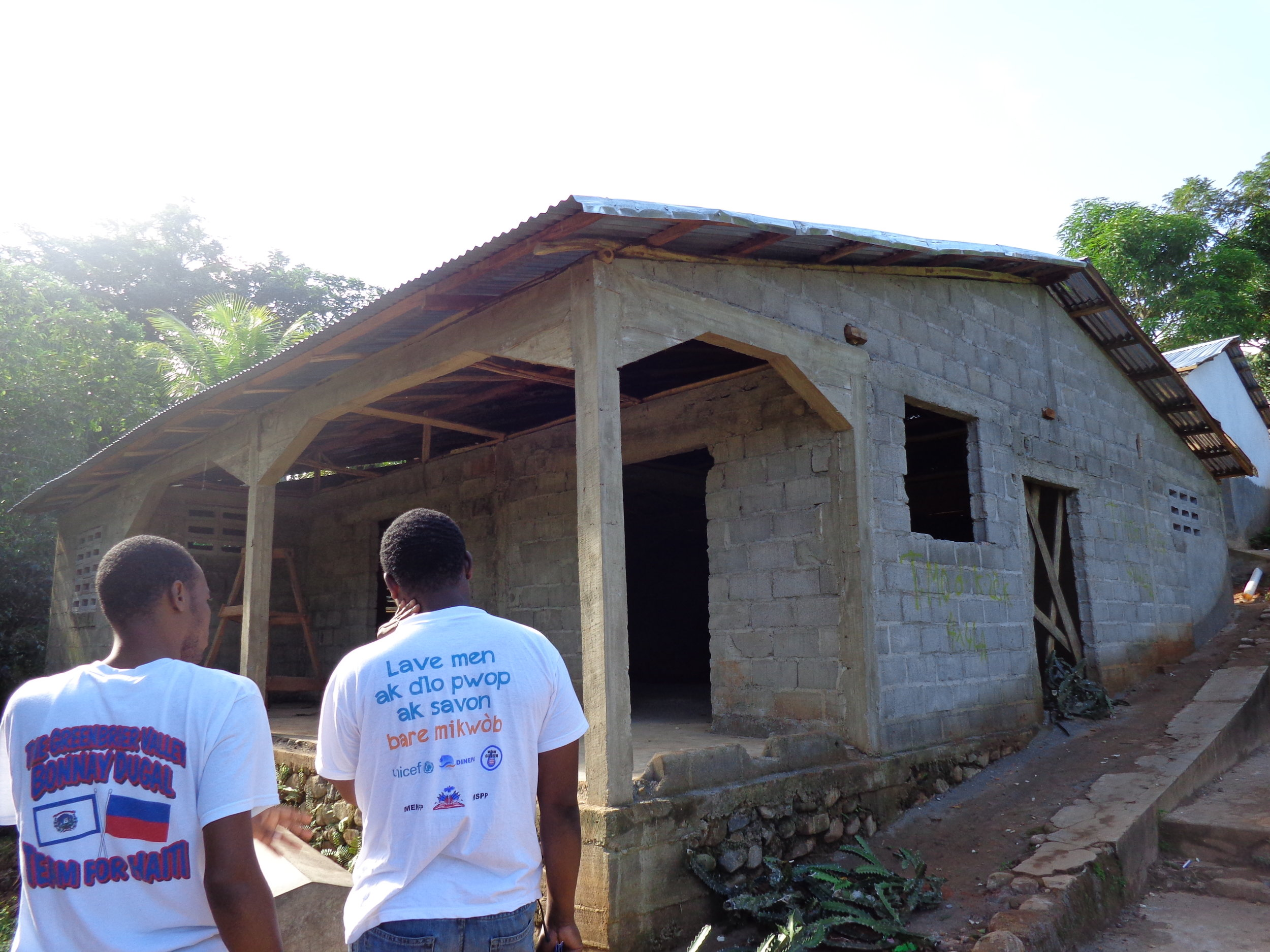 GROW Haiti board members outside of the health center under construction.