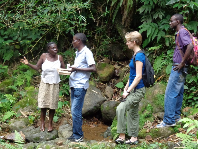 GROW volunteers talk with community members at Soufriere about the best locations for additional water systems to be built in even more remote areas.