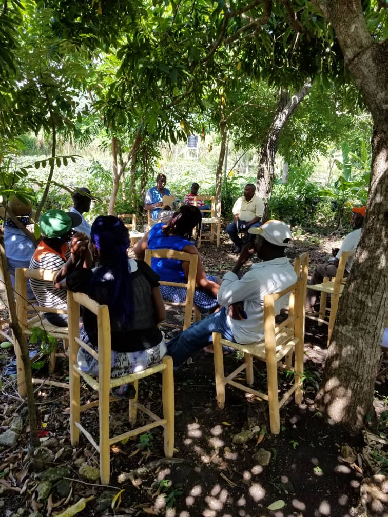 GROW Haiti board members, PDL staff, and farmer cooperative members discuss the implementation of a new loan initiative at St. Rafael, Haiti.