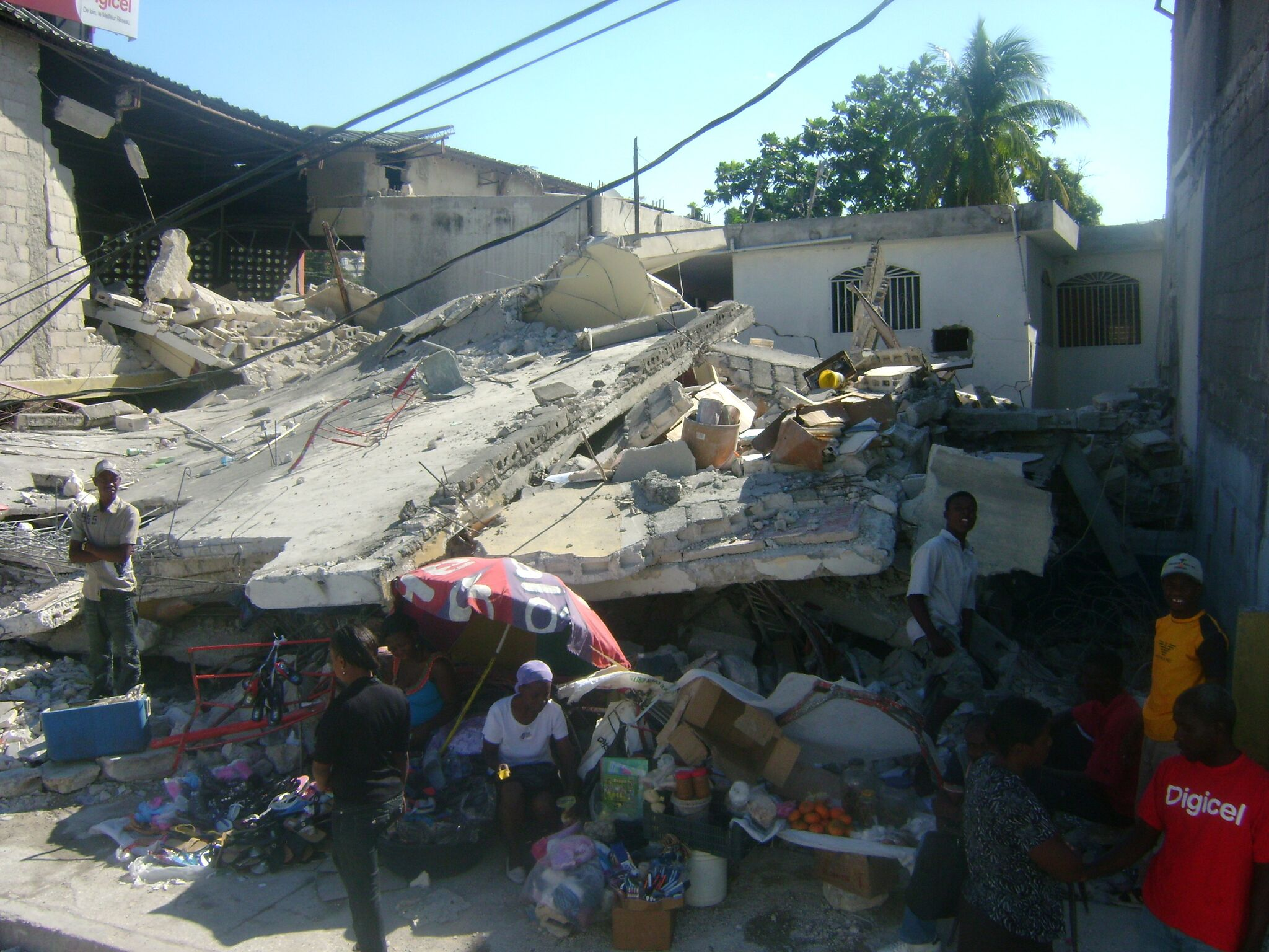 A roadside stand pops up again within days of the earthquake amid the destruction in Port au Prince.
