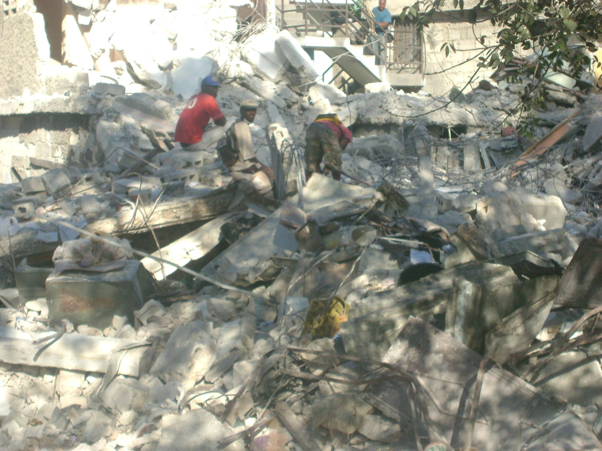 Volunteers and local officials search for survivors in the rubble after the quake in Port au Prince.