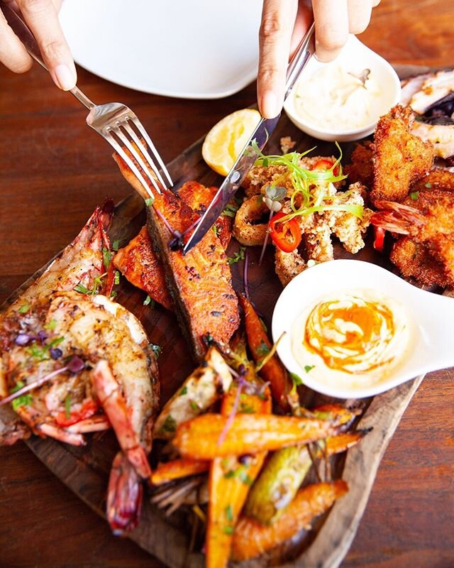 Designed for when you can't quite decide what to order and feel like trying a little bit of everything, our new sharing platters are the ultimate seafood (or meat) selection. Our seafood platter has tiger prawns, crumb-fried prawns, grilled octopus, calamari, pan-seared salmon, roasted root vegetables, and miso-chilli butter for dipping. Available now on the lunch and dinner menu at our Souk Al Bahar branch.