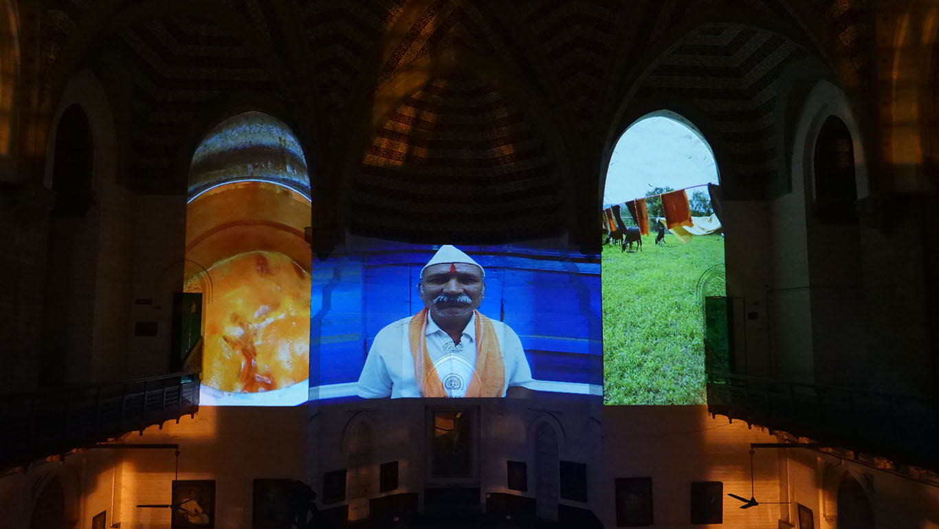 Hidden Lilly, Maharaja Sayajirao University of Baroda, projection narrative and performance, historic Premanand Hall, Baroda, India, November 2017. Photo Credit G. Craig Hobbs.