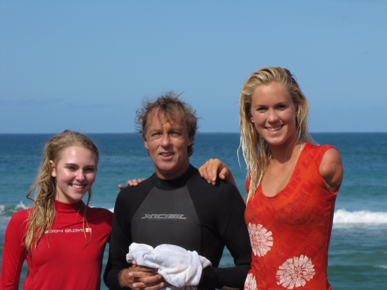 Russell Lewis  - A highly skilled surf coach whose extensive experience at all levels of surf coaching has had a huge impact on the kids of the North Shore of Kauai.Picture shown with Bethany Hamilton http://bethanyhamilton.com one of Russell's successful students.