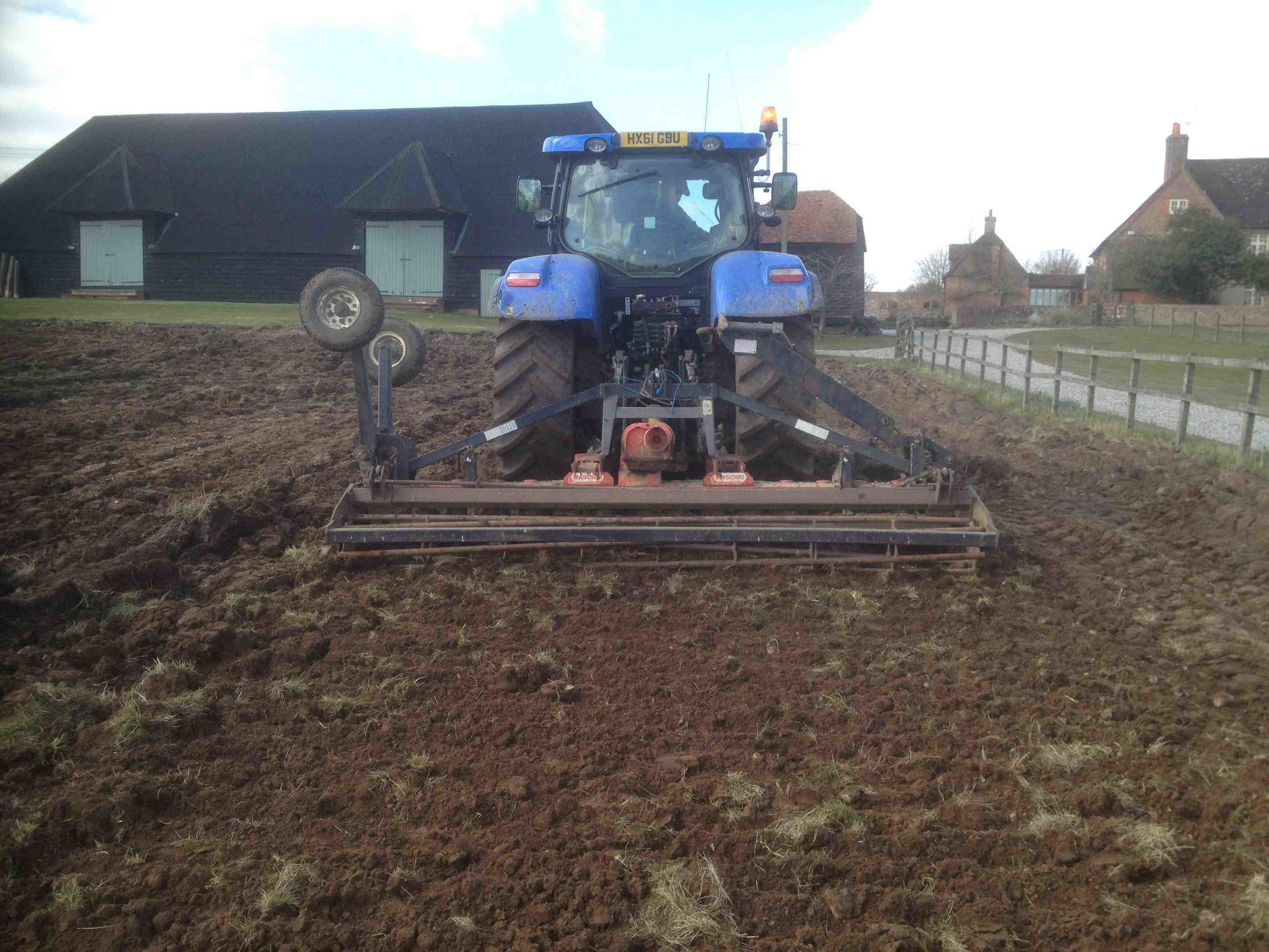 2. preparing the land harrowing tractor low res copy.jpg