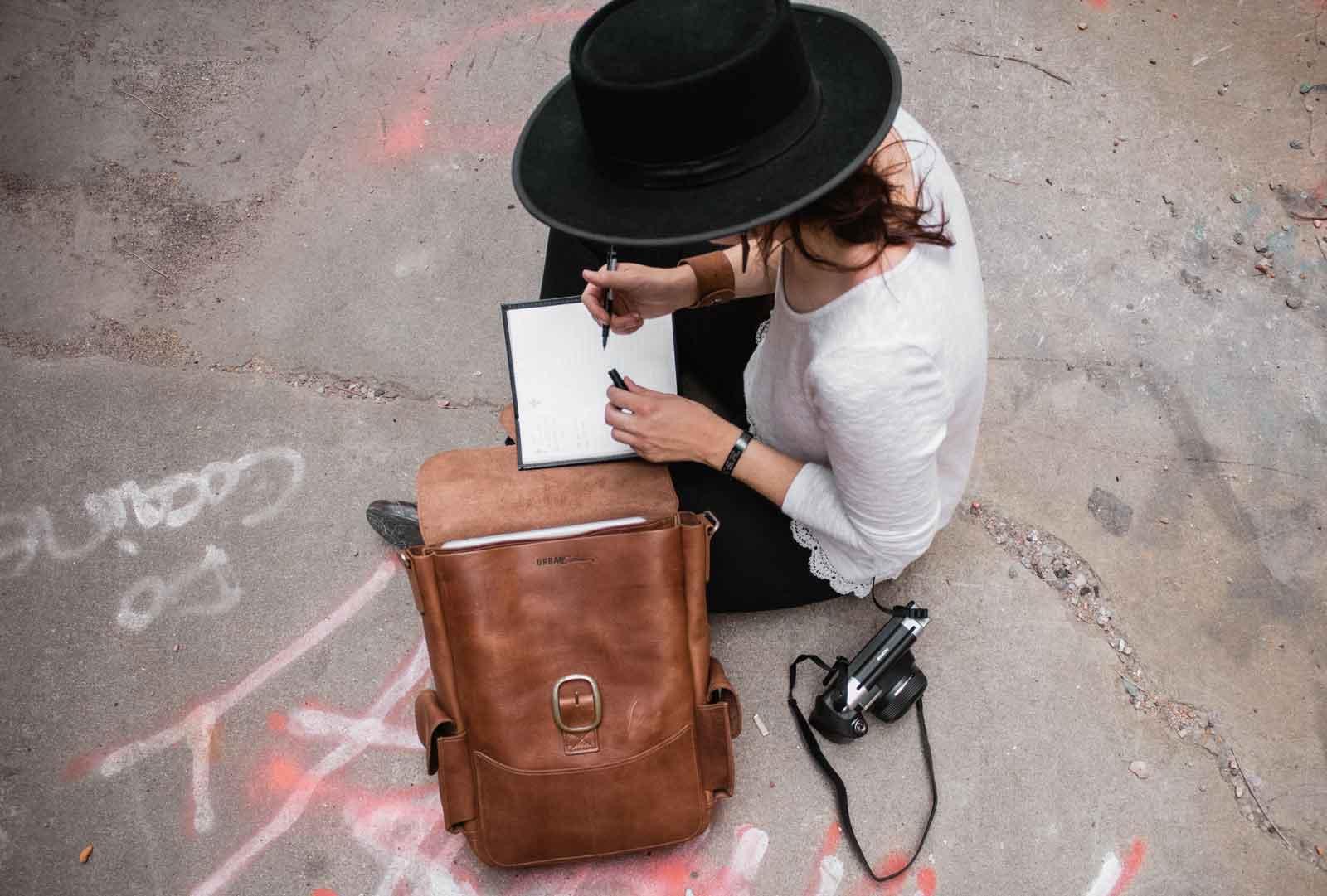 meg_delagrange_writing_author_leather_bag.jpg
