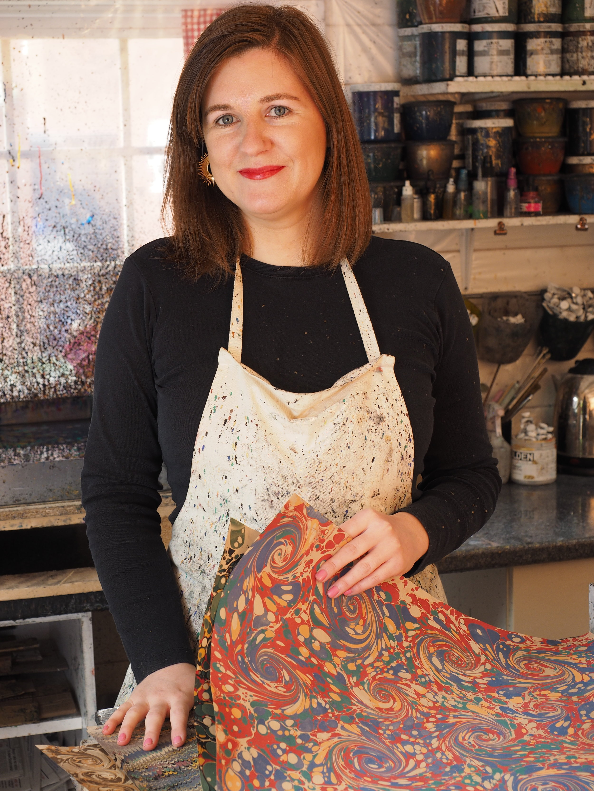 A portrait of Jemma Lewis in her marbling studio.