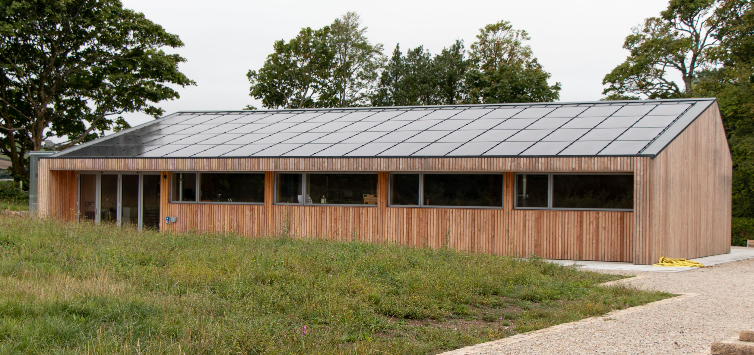 Solar panels run across James Smith Designs workshop roof, a building designed by James Smith and his brother Tom Smith of Gluckman Smith Architects.