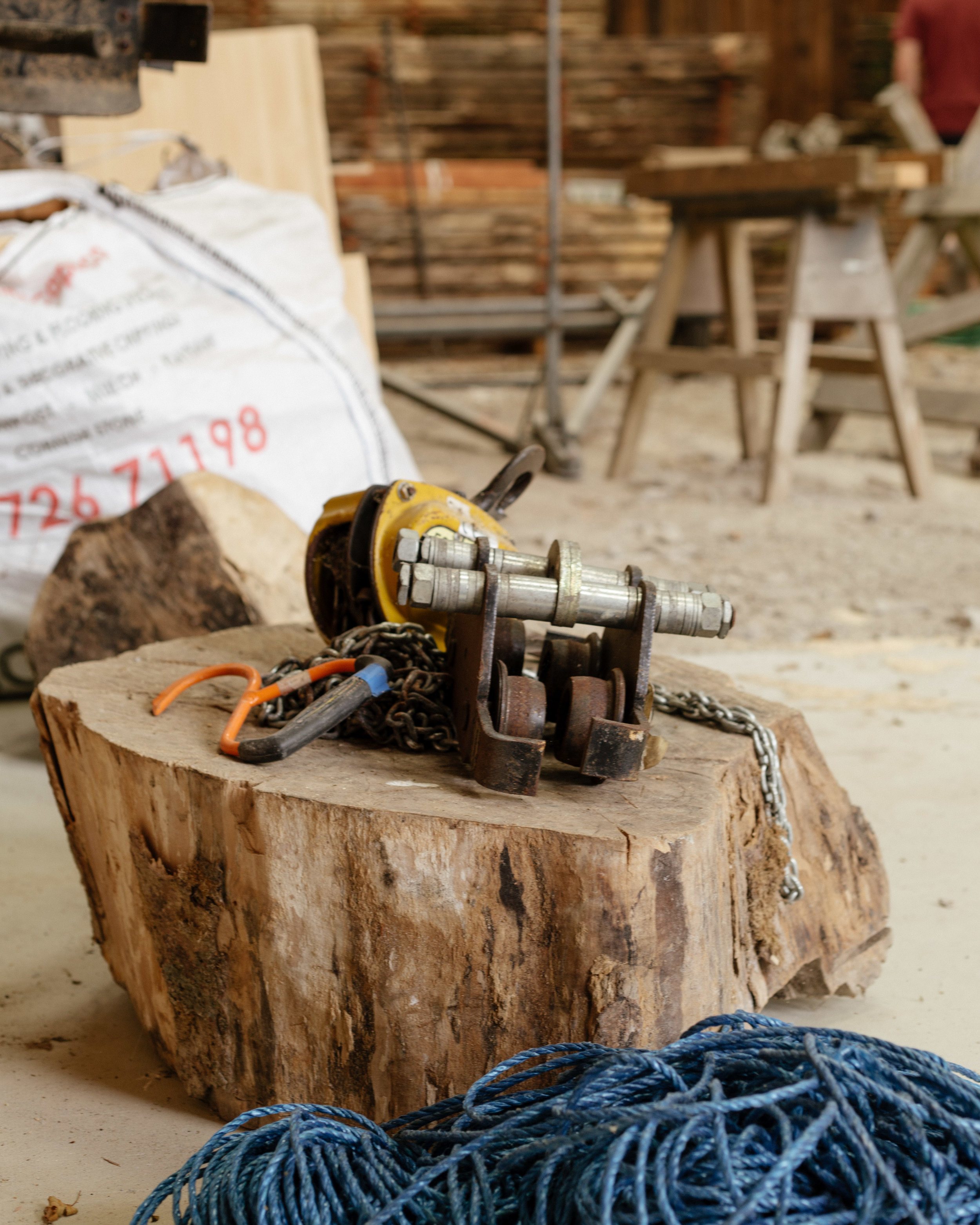 Power tools and milled timber in the barn at Argal Home Farm.
