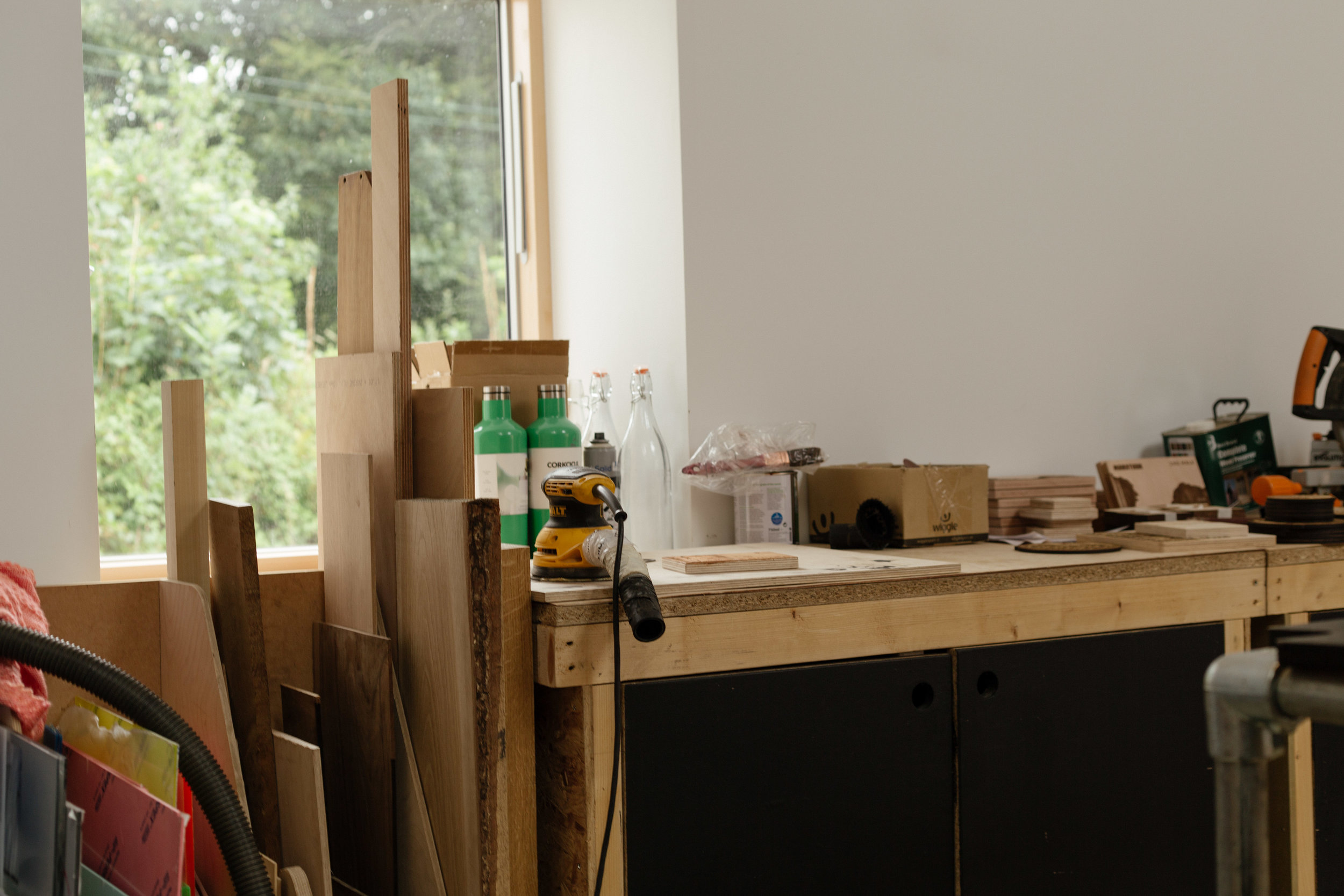 Plywood and power tools in Cut by Beam's workshop at Argal Home Farm.