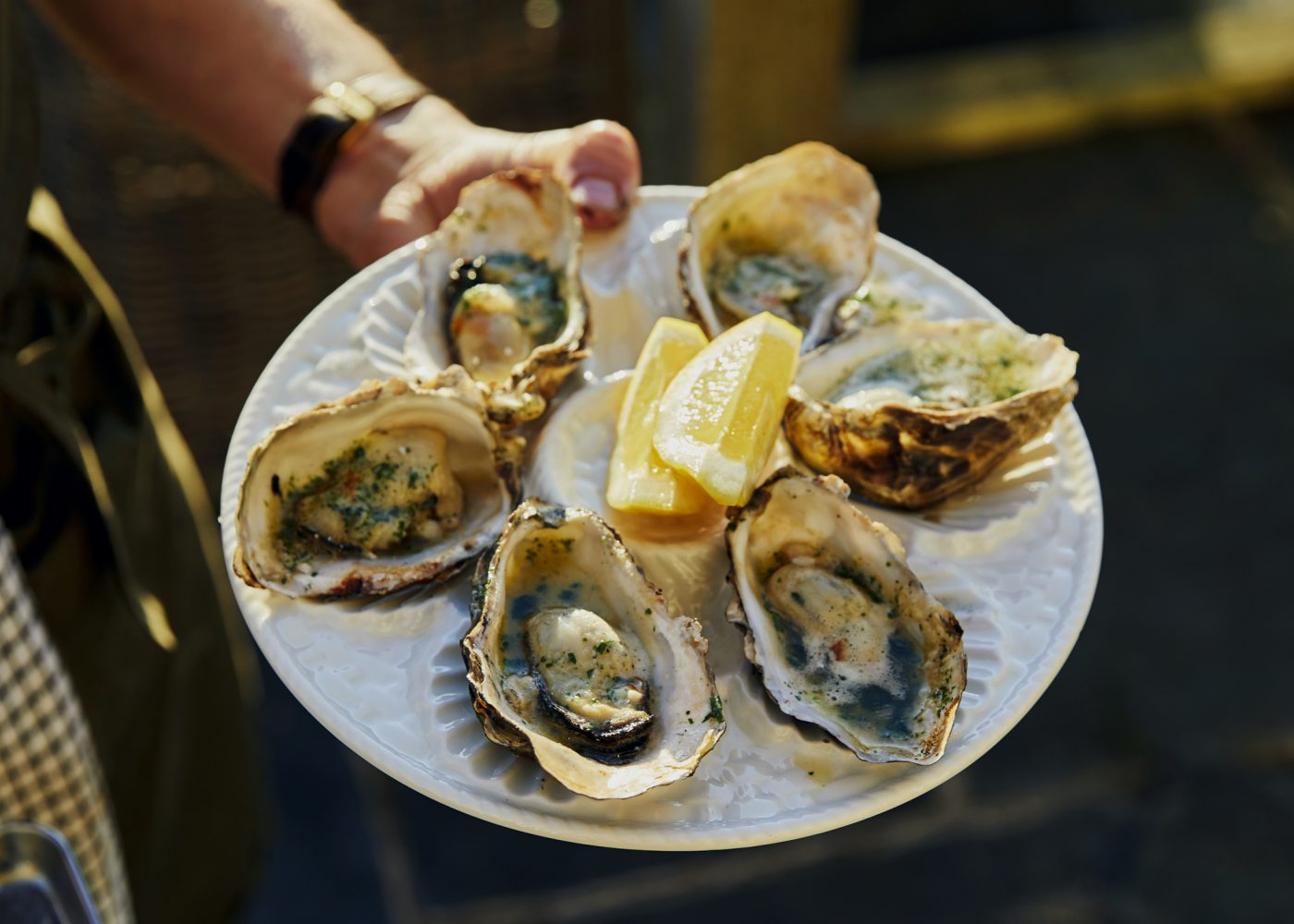 Serving up fresh local oysters. Louise & Tim's supper club at Treverra Farm, Cornwall. Photo by Emli Bendixen.