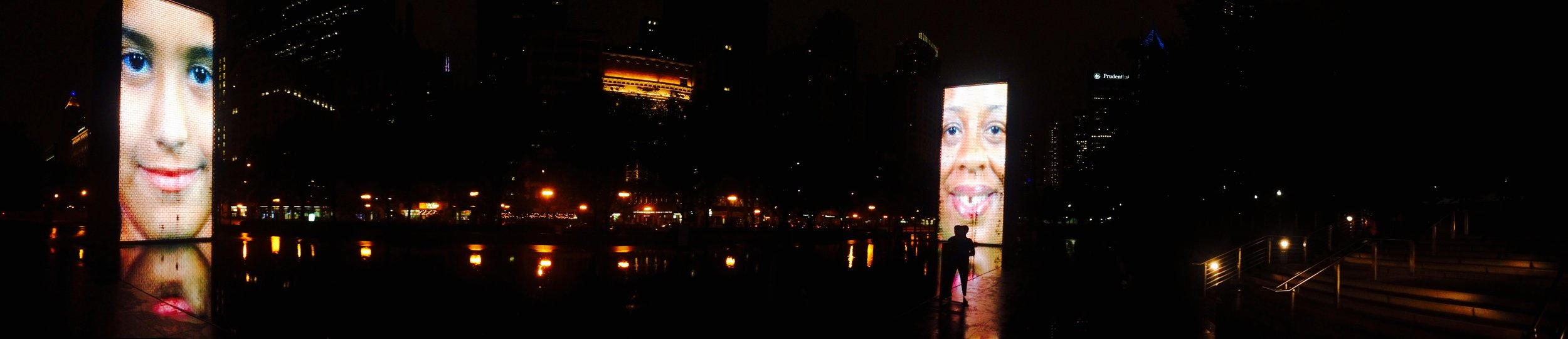 Crown Fountain at night by  Catalan artist Jaume Plensa ,
