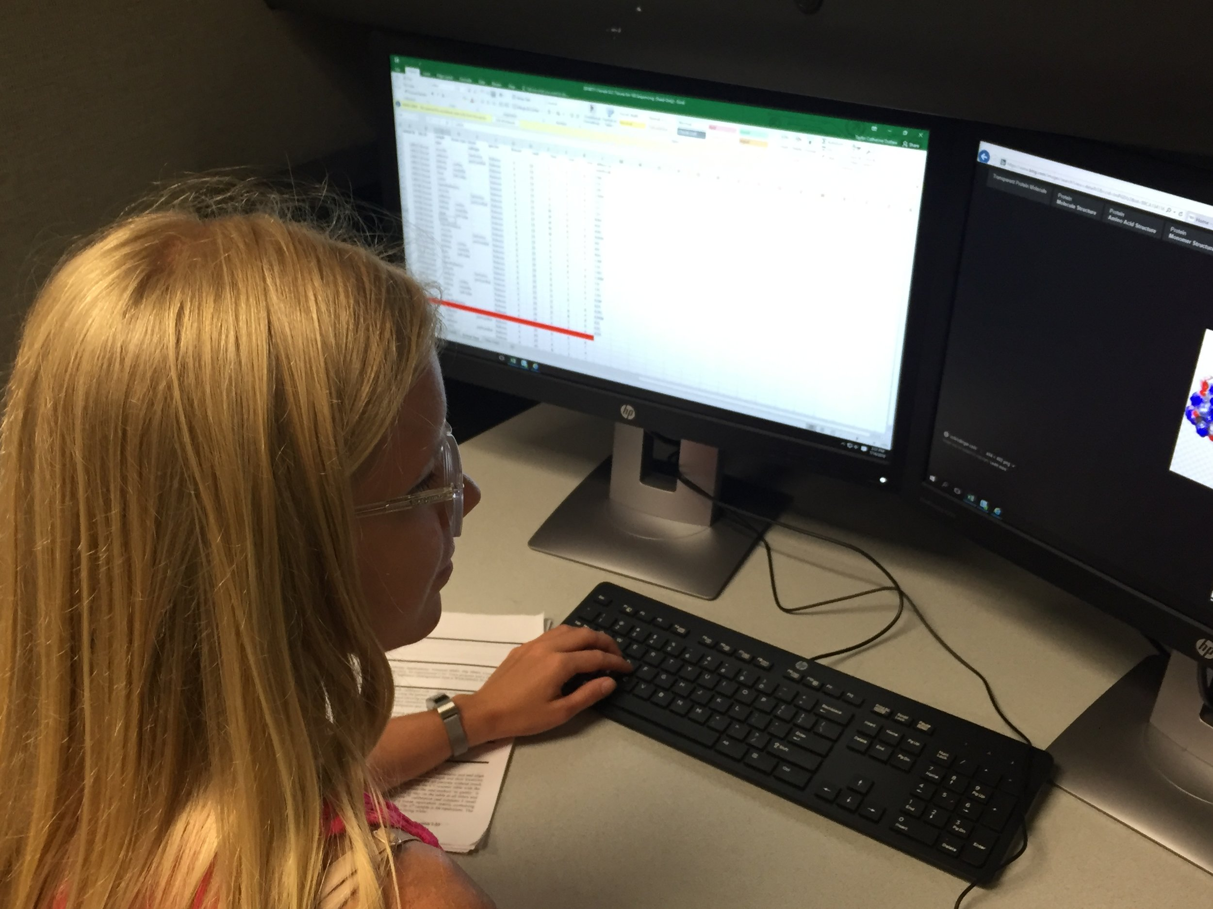 Summer student intern Taylor Outlaw analyzing data