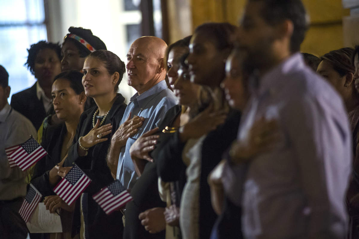 Naturalized citizens from across the world take their oath at a local oath ceremony