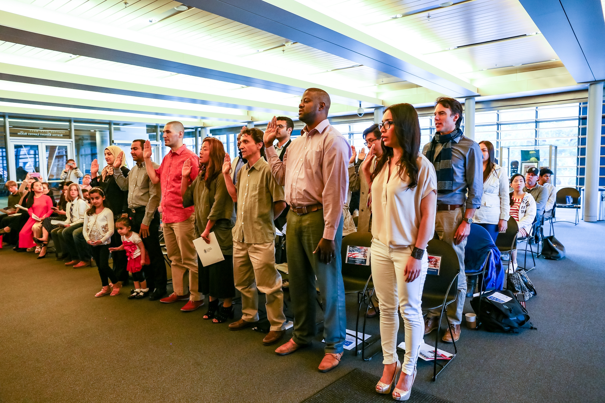 Seattle's Office of Immigrant and Refugee Affairs' (OIRA) New Citizen Program welcomed 19 new Americans at a Flag Day Naturalization Ceremony at Seattle City Hall. (Photo credit: Alabastro Photography)
