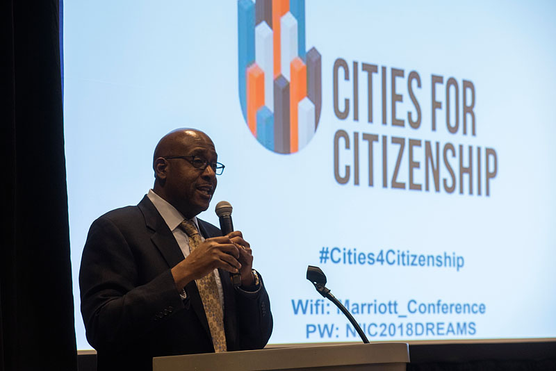 Chair of Arlington County Board, Christian Dorsey, welcomes attendees at the Cities for Citizenship (C4C) Municipal Gathering, and announces that Arlington County will join the C4C network