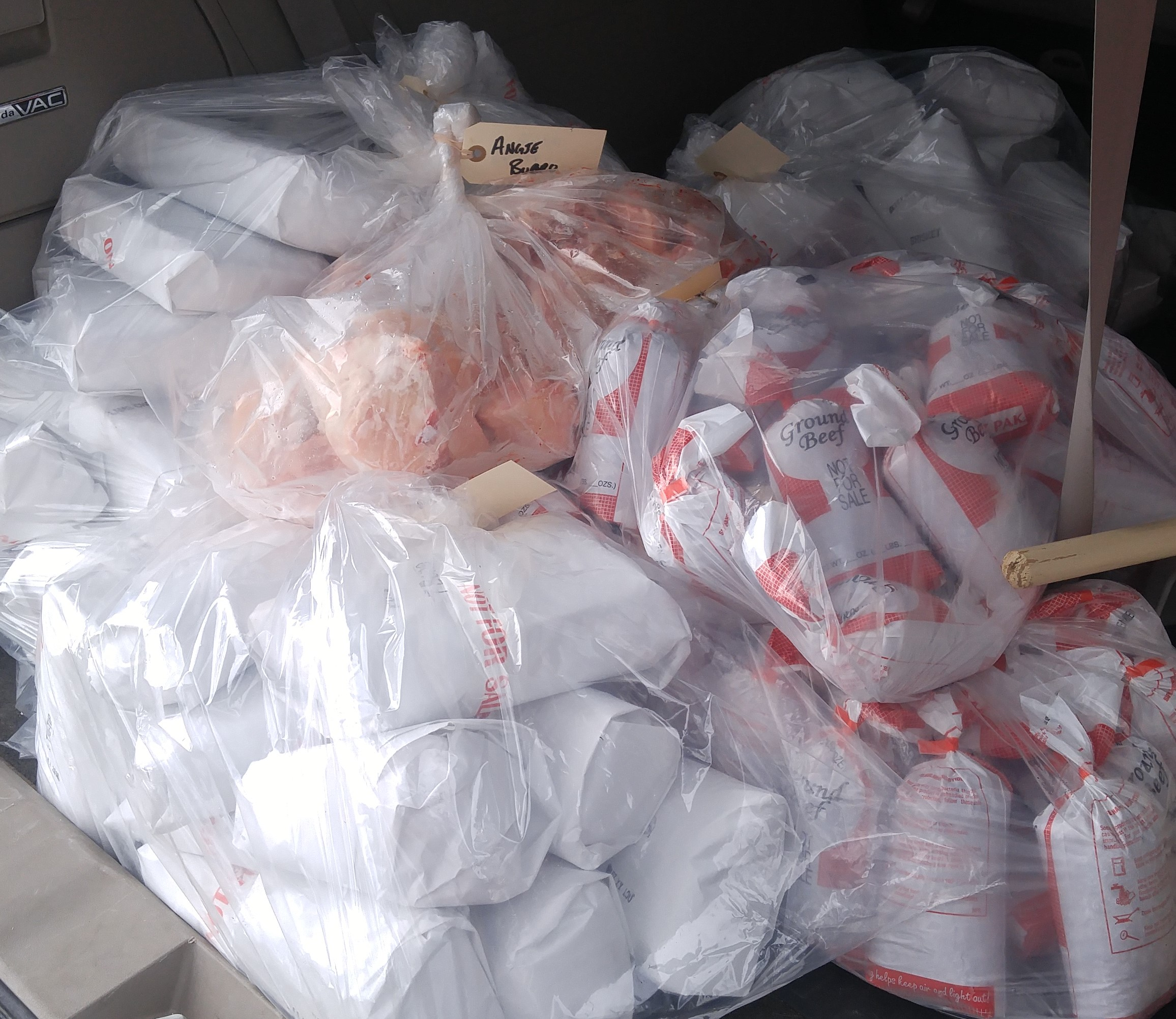Half a beef and a small lamb in the back of my van after pick-up from the butcher shop. This needs some organization! Note the tags banded to the bags - you can use the back of these to label your bags!