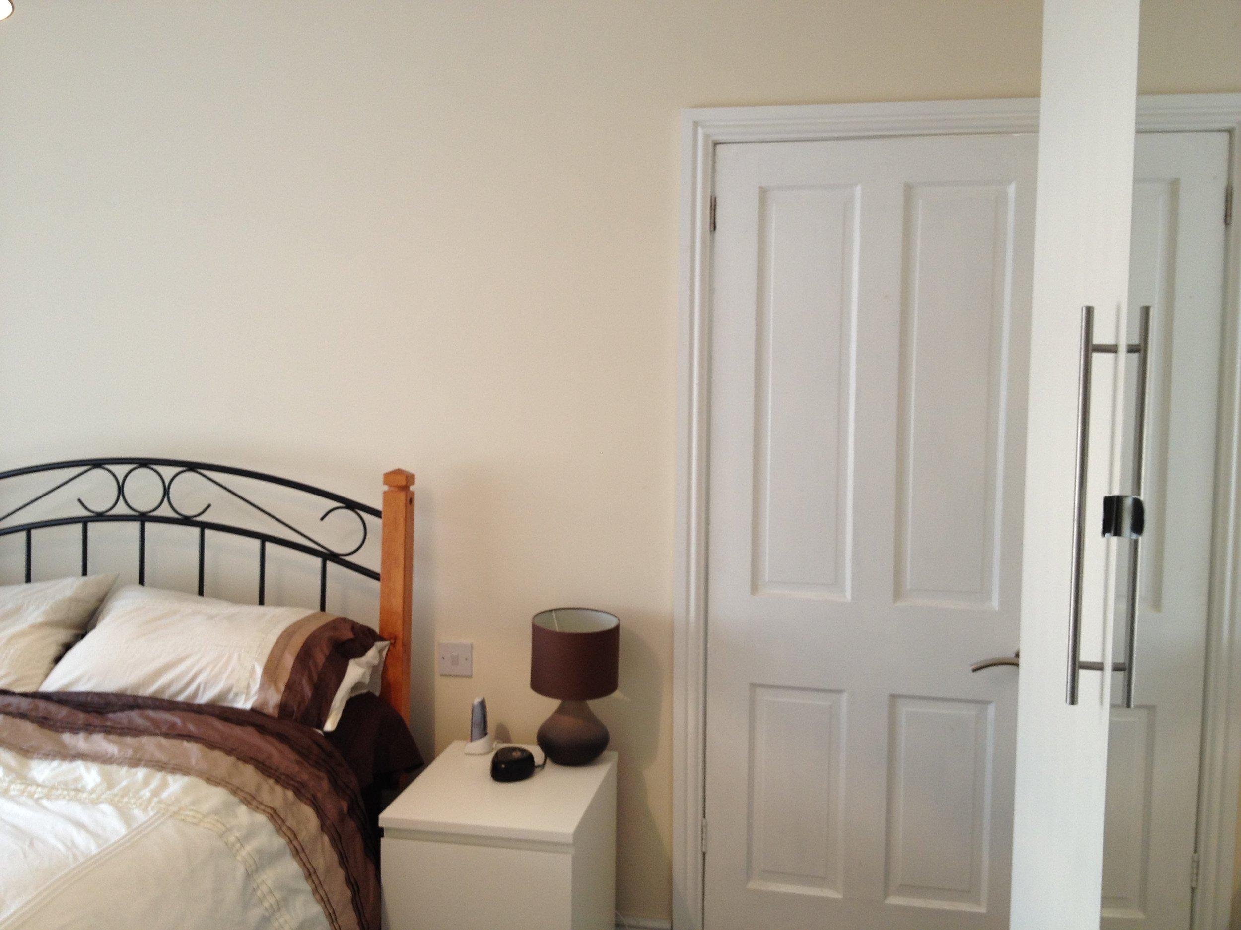 Over-skimmed plastered bedroom walls