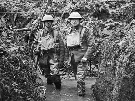 Soldiers standing in trench - wet boots