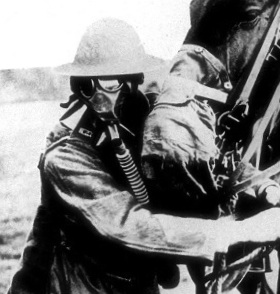 American soldier and horse - both wearing gas masks!