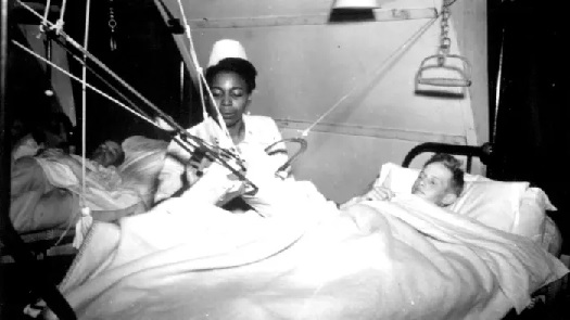 Nurse caring for patient POW Hospital