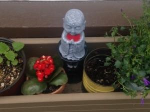 Window box with Jizo statue