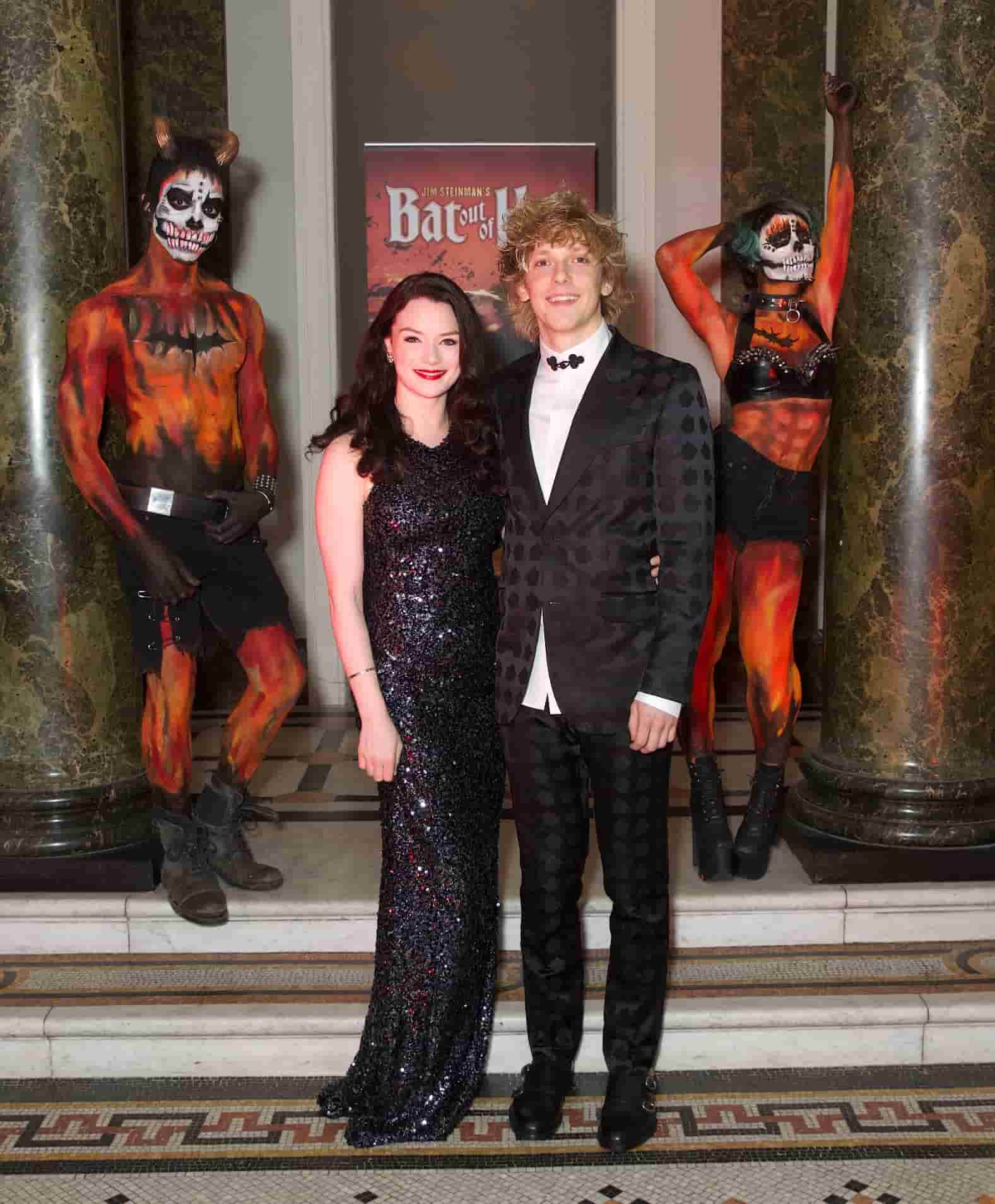 Some of the cast with performers in the reception of 116 Pall Mall