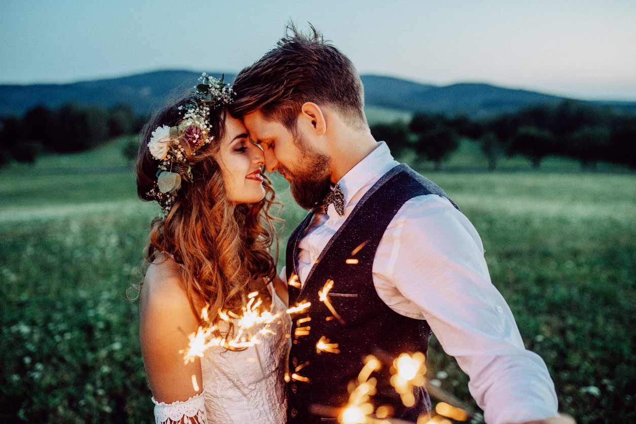 Bride and groom with sparkler