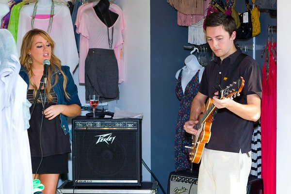 Singer and songwriter, jessica carder providing entertainment at the inaugural divas dressing darlings event held at RK collections boutique in little rock.