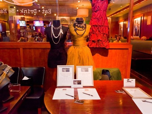 Silent Auction items at the Your girl Friend's closet event benefiting the nonprofit, women and children first. Held at bar louie in little rock, arkansas.
