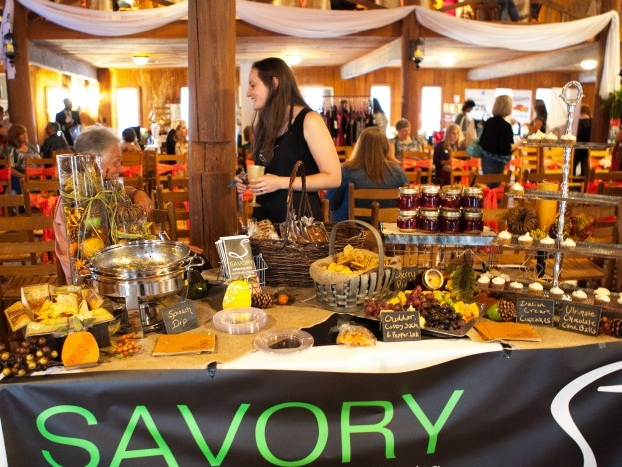 Bridal Savoir Faire vendor booth, Savory Catering, at the event hosted at Cypress Meadows.