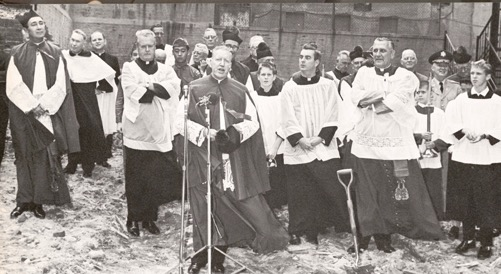Msgr Farriker blesses site of new church, which was completed in 1966, three years after the fire.
