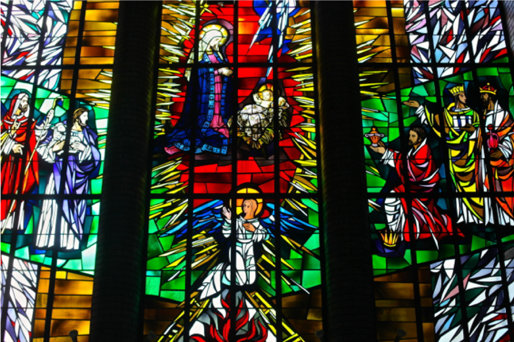 The Epiphany Window of the Madonna and Child that survived the fire. It is installed in the Narthex of the current church.