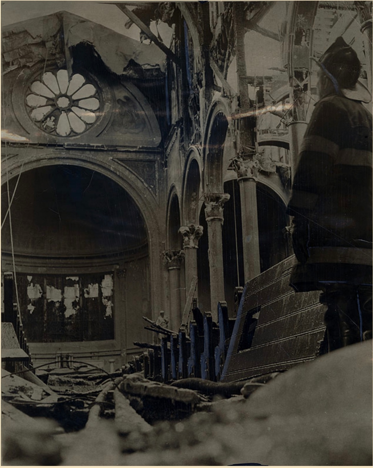 Epiphany interior after fire 1963 - Fireman J. De Bellonia surveys the ruins of the fire-gutted Epiphany Roman Catholic Church on 2nd Avenue.