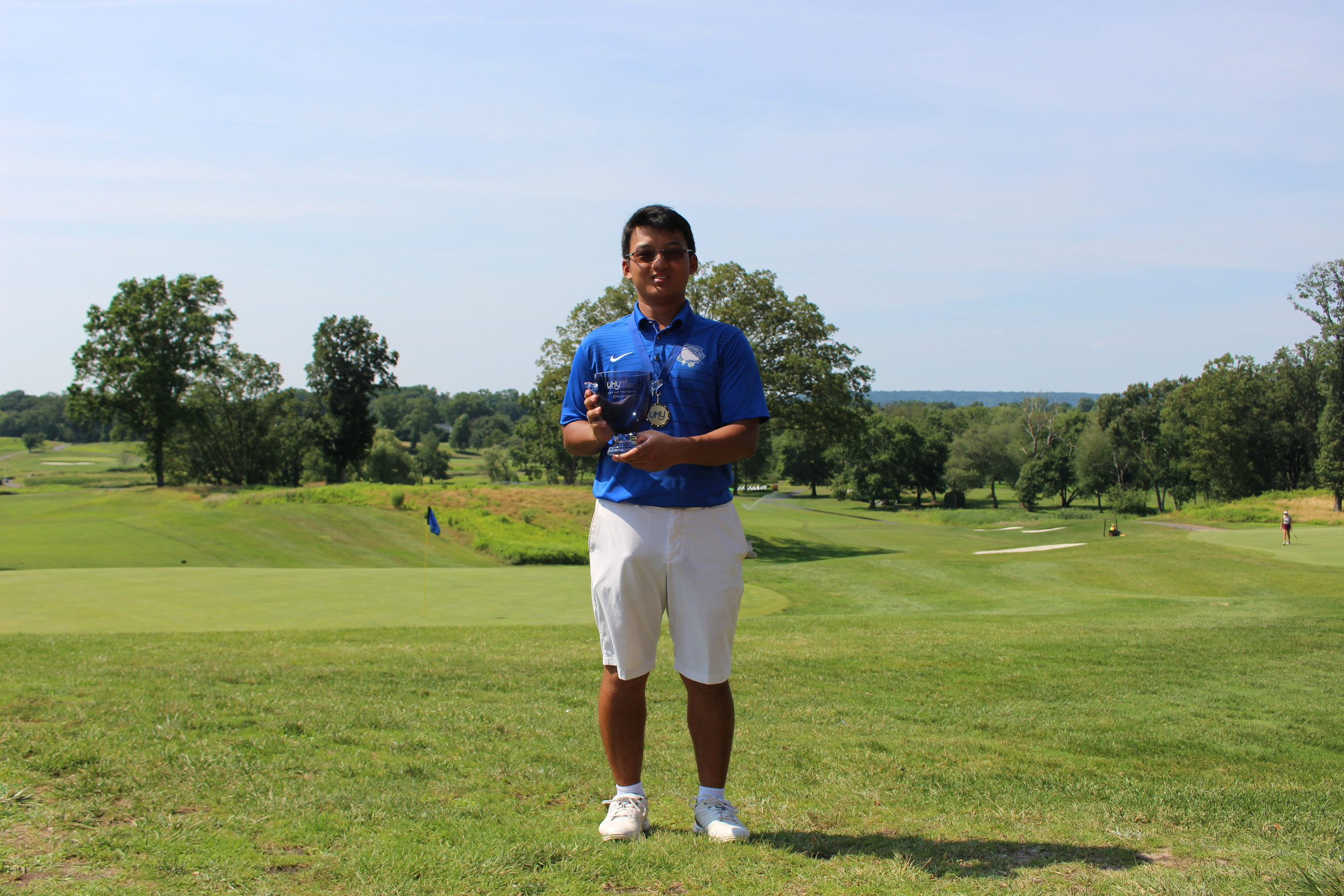Yida Wang from Potomac, MD was the boys champion, with a 142 total (76-66).