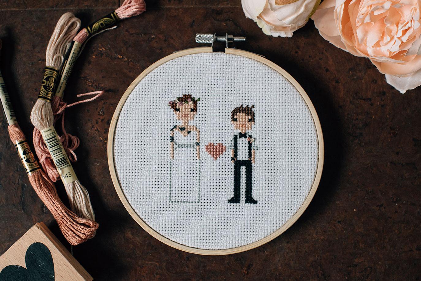 Custom cross-stitch of a same-sex LGBTQ couple by Sara Wilde