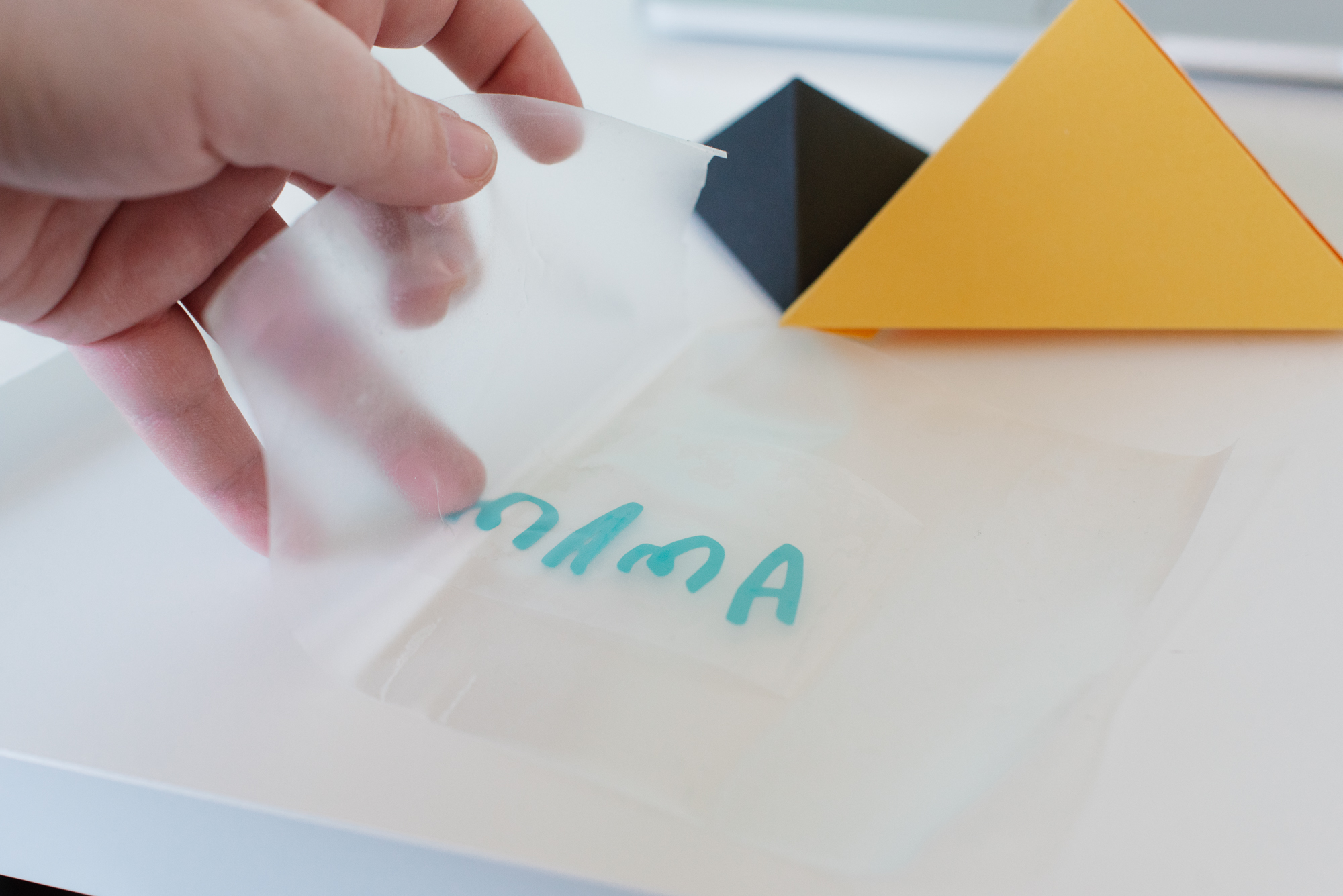 Placing contact paper on vinyl lettering