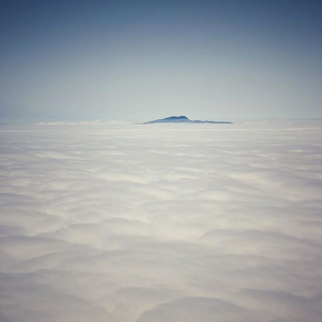 not sure but looks like Mountain Halla in Jeju, South Korea. #jeju #jejuisland #cloud #viewfromplane #iphone #landscape #nature #korea #제주도 #한라산 #한라산같은데 #구름 #뱅기밖풍경 #아이폰 #스마트폰사진