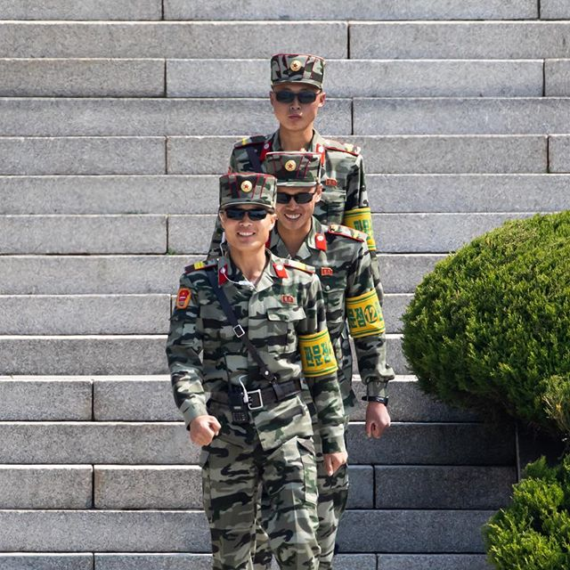 North Korean soldiers outside the Panmungak pavilion seen from the truce village of Panmunjom in the demilitarized zone in Paju, South Korea. #onassignment @bloombergbusiness #northkorea #southkorea #korea #soldiers #dmz #panmunjom #photojournalism #army #canon #판문점 #사진기자 #외신기자 #북한 #웃는북한군 #캐논